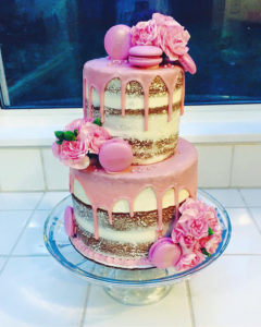 A fresh and fun semi-naked cake with flowers & macarons.